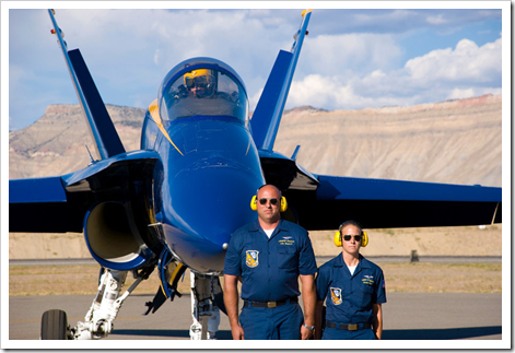 Blue Angel Pilot, Lt. Mark Swinger parks Blue Angel #3 with Crew Chief AO1(AW) Katie Kilbourn and Life Support Tech AME1(AW) Kevin Swanner posting